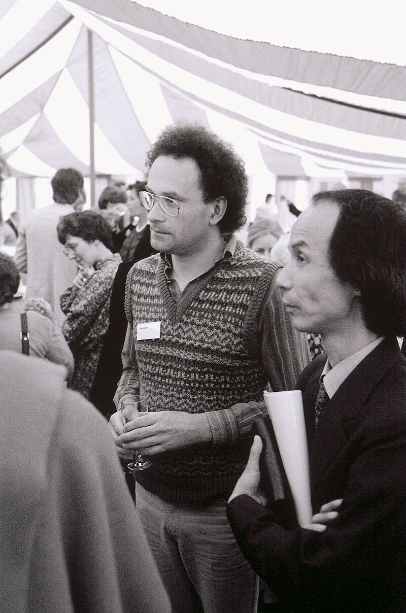 Colin Matthews and Toru Takemitsu in conversation with someone out of camera shot