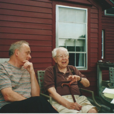 Colin Matthews and Elliott Carter sitting chatting outside a house