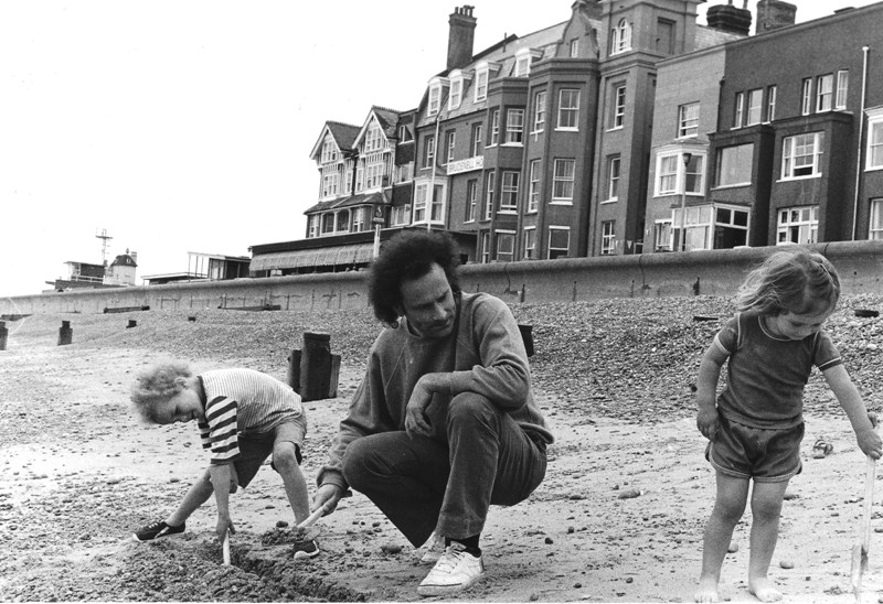 CM with son Dan and daughter Lucy digging in the pebbles on the beach
