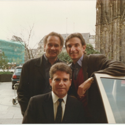 CM, Michael Tilson Thomas & Joshua Robison posing outside next to a car door