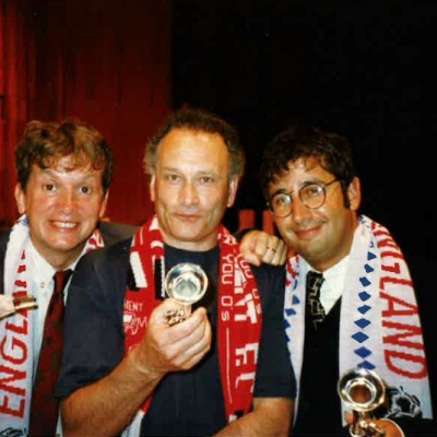 Frank Skinner, Colin Matthews, David Baddiel, with toy instruments and wearing footbal scarves