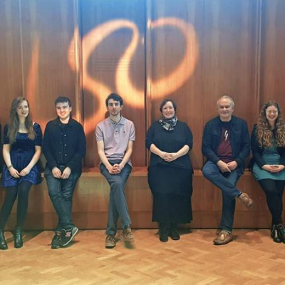 Line up of of 2017-18 panufnik composers with LSO symbol in background