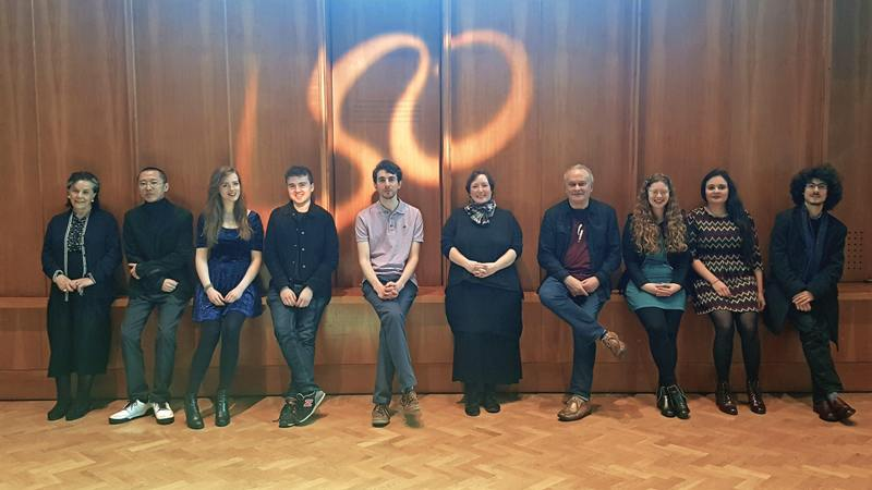 Line up of of 2017 panufnik composers with LSO symbol in background