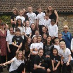 Group photo of the Magdalen Farm Strings course participants (about 25 children plus tutors)