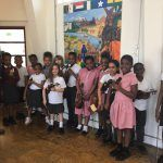 Colin Matthews with a group of 14 primary school children, all holding violins