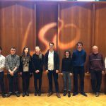 the 8 panufniks composers plus colin matthews lined up together with the LSO logo in the background