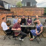Composers on the course plus Colin Matthews, sitting outside at snape maltings having a drink