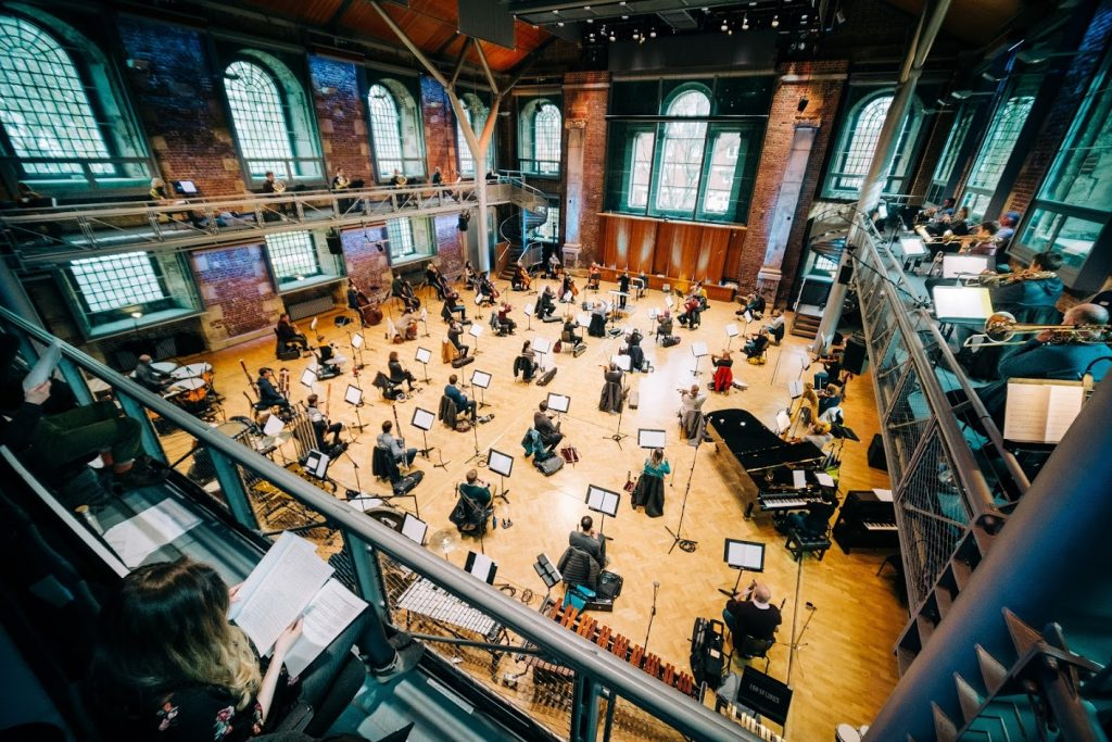 The London Symphony Orchestra rehearsing, pictured above from the balcony - all socially distanced