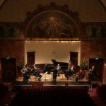 The Nash Ensemble on stage at the Wigmore Hall - 9 players, 1 singer, 1 conductor