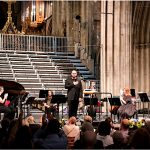 Performers on stage receiving applause at the end of the Great Journey in Worcester Cathedral